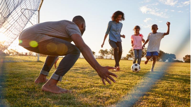 boy-kicks-football-during-game